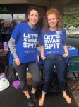 two women University of Hawaiʻi students wearing Let's Swab Spit t-shirts